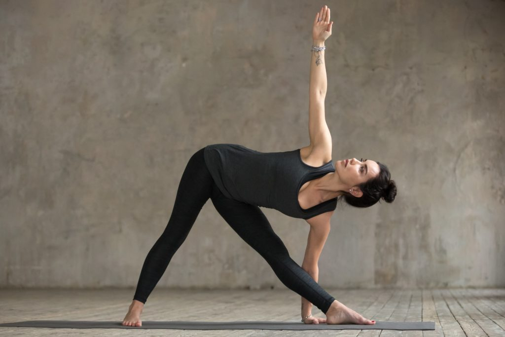 Extended Triangle Pose   Top 9 Yoga poses for stress relief   moveOn 89